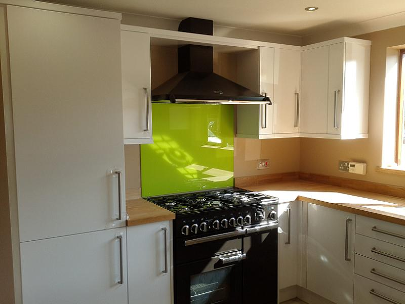 Logica White Gloss Kitchen Fitted With Oak Worktops Meadows Kitchens