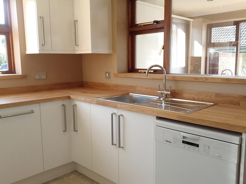 Logica White Gloss Kitchen Ed With Oak Worktops
