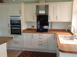 Richmond Ivory painted kitchen fitted with oak worktops